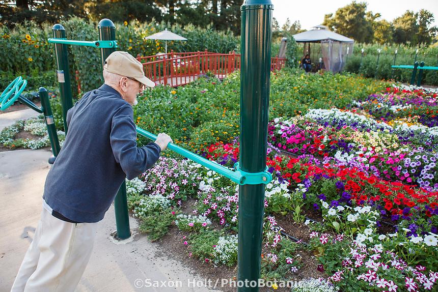 Bob, elderly resident exercising in the Community Garden at Healdsburg Senior Living Center