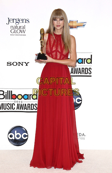 Taylor Swift.2012 Billboard Music Awards Press Room at the MGM Grand Garden Arena Las Vegas, Las Vegas, Nevada, USA..May 20th, 2012.full length red dress lace sleeveless award trophy.CAP/ADM/MJT.© MJT/AdMedia/Capital Pictures.