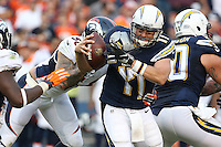 San Diego Chargers quarterback Philip Rivers #17 and Denver Broncos linebacker Shane Ray #56 during an NFL game between the Denver Broncos and the San Diego Chargers played at Qualcomm Stadium on December 6, 2015. (AP Photo/Michael Zito)