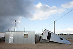 "CAPE TOWN, SOUTH AFRICA - MAY 3: A tin house has blown away by strong wind on May 3, 2010, in Blikkiesdorp about 40 kilometers south of Cape Town, South Africa. Blikkiesdorp, which is Afrikaans for ""Tin Can Town"", was given its name by its residents because of the row-upon-row of tin-like shacks made of corrugated iron. It was built by the City of Cape Town in 1997 and about 1600 one-roomed shacks were built. It has been known for its bad conditions and a dumping ground for shack dwellers from other areas around Cape Town. Recently many street people in Cape Town has been forcefully removed and relocated to this place. The ones that have refused has been put in holdings cells or prisons such as Pollsmoor Prison. This campaign has  identified in the preparation for the soccer World Cup, who starts on June 11, 2010 and goes on for a month. The City of Cape Town doesn't want international visitors to be hassled by street people. (Photo by Per-Anders Pettersson)"