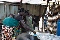Uganda - Adjumani - Caretakers of the orphanage cook for the children.<br /> Created in 1994, the orphanage is managed by South Sudanese International Widows Association to Save Orphans and moved in February 2017 from the South Sudanese city of Kajo-Keji to Uganda because of security reasons. It currently hosts 55 children in the city of Adjumani and an additional 27 in Palorinya refugee camp.