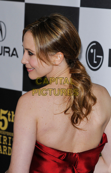 VERA FARMIGA.The 25th Annual Film Independent Spirit Awards at the LA Live Event Deck in Los Angeles, California, USA..March 5th, 2010  .headshot portrait red strapless silk satin half length profile back behind rear ponytail .CAP/ROT.©Lee Roth/Capital Pictures