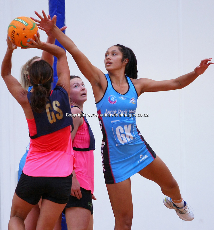 Steel's Phoenix Karaka, right, defends Legend's Tania Dalton's shot at goal in the Steel v Legends match, Edgar Centre, Dunedin, New Zealand, Saturday, March 16, 2013. Credit:NINZ/Rob Jefferies