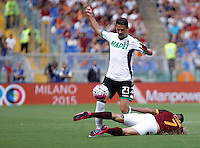 Calcio, Serie A: Roma vs Sassuolo. Roma, stadio Olimpico, 20 settembre 2015.<br /> Sassuolo&rsquo;s Marcello Gazzola, left, and Roma&rsquo;s Juan Iturbe fight for the ball during the Italian Serie A football match between Roma and Sassuolo at Rome's Olympic stadium, 20 September 2015.<br /> UPDATE IMAGES PRESS/Isabella Bonotto