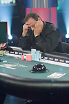 "Charidimos ""Harry"" Demetriou agonizes making the call on the final hand of play.  He did make the call, but lost."