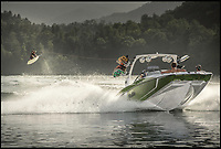 BNPS.co.uk (01202 558833)<br /> Pic: Malibu/BNPS<br /> <br /> Surfs Up...whatever the weather.<br /> <br /> This innovative speedboat that has a hull specially designed to generate big waves for wakeboarders is leaving other vessels in its wake. <br /> <br /> Unnaturally rough waters are created by adding weight to the certain areas of the boat, meaning the trail of water behind is more turbulent. <br /> <br /> This means that even if surfing on the calmest of waters wakeboarders will be able to ride big waves and generate big air. <br /> <br /> The patented system from boat maker Malibu comprises four large tanks, two at the front and two at the back, that can be filled with and emptied of water at the click of a button.