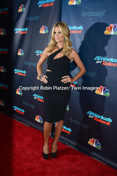 "Heidi Klum in Versace black dress attends the ""America's Got Talent"" pre show red carpet on September 17, 2013 at Radio City Music Hall in New York City."
