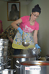 In a community kitchen in Minyara, a village in the Akkar district of northern Lebanon, Zena Aboud ladles the soup she and other women have prepared for Syrian refugees living in a nearby informal settlement. Lebanon hosts some 1.5 million refugees from Syria, yet allows no large camps to be established. So refugees have moved into poor neighborhoods or established small informal settlements in border areas. International Orthodox Christian Charities, a member of the ACT Alliance, provides a variety of assistance to families in this settlement, including support for the community kitchen.