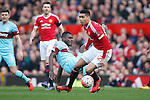 Chris Smalling of Manchester United battles Emmanuel Emenike of West Ham during the Emirates FA Cup match at Old Trafford. Photo credit should read: Philip Oldham/Sportimage