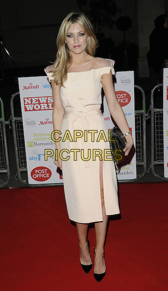 ABI CLANCY (ABIGAIL).At the Children's Champions Awards 2010, Grosvenor House Hotel, Park Lane, London, England, UK, .March 3rd 2010..arrivals full length  Clancey cream beige dress sheer mesh see thru through waist belt slit split black  shoes clutch bag pointy christian louboutin .CAP/CAN.©Can Nguyen/Capital Pictures.