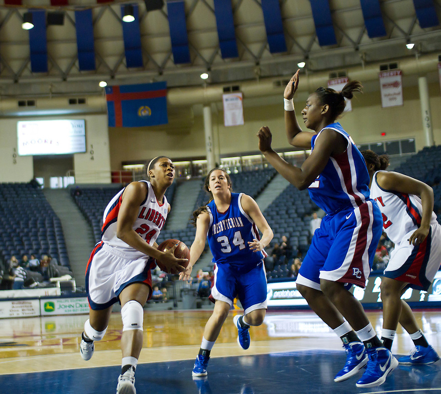 Ladyflames Women's Basketball Team defeats the Presbyterian Blue Hose, Jan 21, 2012. Photo taken by Scott Hill