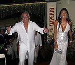 Flavio Briatori and wife Elizabetta Gregoraci..Fawaz Gruosi, De Grisogno Jewelry owner, 57th Birthday Party..Billionaire Nightclub..Porto Cervo, Sardinia, Italy.Saturday, August 08, 2009..Photo By Celebrityvibe.com.To license this image please call (212) 410 5354; or Email: celebrityvibe@gmail.com ; .website: www.celebrityvibe.com.