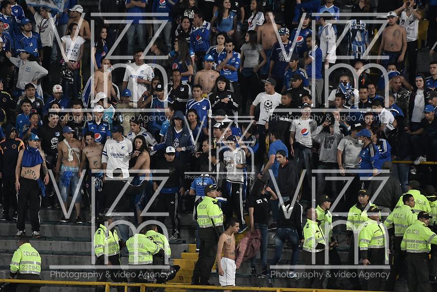 BOGOTA - COLOMBIA -06 -08-2017: Hinchas de Millonarios son controlados por la policía después de realizar desordenes en la tribuna sur durante el encuentro entre Millonarios y Atletico Junior por la fecha 6 de la Liga Aguila II 2017 jugado en el estadio Nemesio Camacho El Campin de la ciudad de Bogota. / Fans of Millonarios are controlled by the police after they made a disturbs in rhe south tribune during match between Millonarios and Atletico Junior for the date 6 of the Liga Aguila II 2017 played at the Nemesio Camacho El Campin Stadium in Bogota city. Photo: VizzorImage / Gabriel Aponte / Staff.