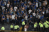 BOGOTA - COLOMBIA -06 -08-2017: Hinchas de Millonarios son controlados por la policía después de realizar desordenes en la tribuna sur durante el encuentro entre Millonarios y Atletico Junior por la fecha 6 de la Liga Aguila II 2017 jugado en el estadio Nemesio Camacho El Campin de la ciudad de Bogota. / Fans of Millonarios are controlled by the police after they made a disturbs in rhe south tribune during match between Millonarios and Atletico Junior for the date 6 of the Liga Aguila II 2017 played at the Nemesio Camacho El Campin Stadium in Bogota city. Photo: VizzorImage / Gabriel Aponte / Staff.