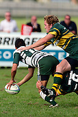 J. Maher with the help of B. Farrell bring P. Talosaga to ground. Counties Manukau Premier Club Rugby, Pukekohe v Manurewa  played at the Colin Lawrie field, on the 17th of April 2006. Manurewa won 20 - 18.