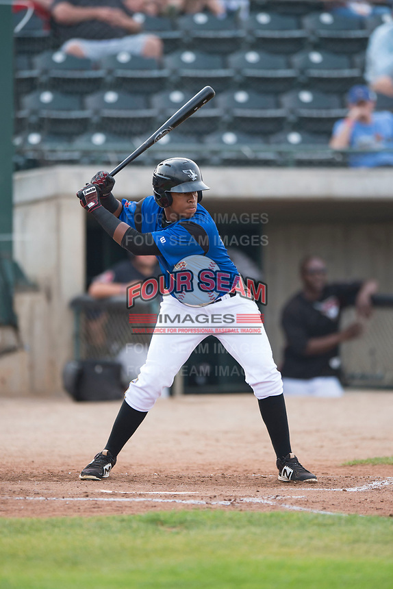 Missoula Osprey right fielder David Sanchez (16) at bat during a Pioneer League game against the Orem Owlz at Ogren Park Allegiance Field on August 19, 2018 in Missoula, Montana. The Missoula Osprey defeated the Orem Owlz by a score of 8-0. (Zachary Lucy/Four Seam Images)