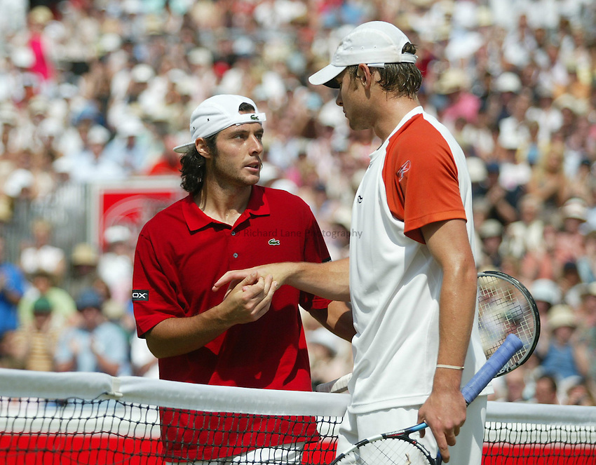 Photograph: Scott Heavey..Final of the Stella Artois Championship at the Queens Club. 15/06/2003..Andy Roddick and Sebastien Grosjean