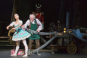22/07/2014. London, England. Shiori Kase as Swanilda/Coppélia Doll and Michael Coleman as Dr Coppélius. Working stage rehearsal of Coppélia with the English National Ballet at the London Coliseum. With Shiori Kase as Swanilda and Yonah Acosta as Franz. Choreography by Ronald Hynd after Marius Petipa to music by Léo Delibes. Music performance by the Orchestra of the English National Ballet conducted by Gavin Sutherland. Photo credit: Bettina Strenske