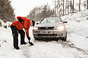 10/12/17<br /> <br /> A motorist uses a shovel after getting stuck in the Goyt Valley, near Whaley Bridge in the Derbyshire Peak District. <br />   <br /> All Rights Reserved F Stop Press Ltd. +44 (0)1335 344240 +44 (0)7765 242650  www.fstoppress.com