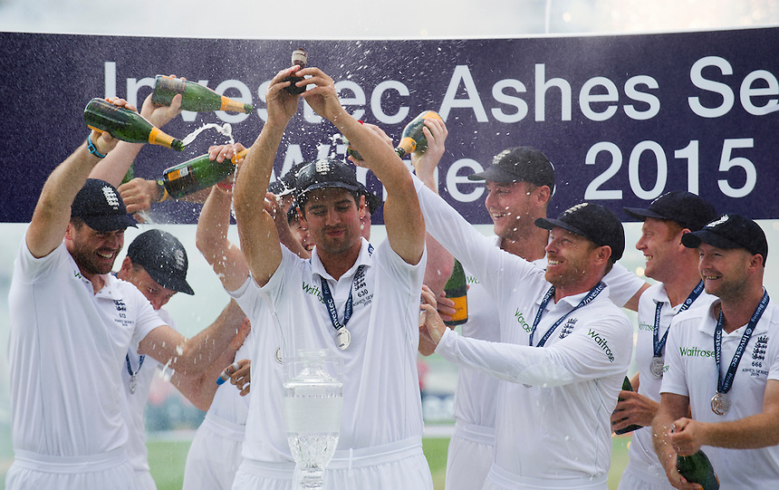 England's Alastair Cook lifts the urn as they win back the Ashes 3-2<br /> <br /> Photographer Ashley Western/CameraSport<br /> <br /> International Cricket - Investec Ashes Test Series 2015 - Fifth Test - England v Australia - Day 4 - Sunday 23rd August 2015 - Kennington Oval - London<br /> <br /> &copy; CameraSport - 43 Linden Ave. Countesthorpe. Leicester. England. LE8 5PG - Tel: +44 (0) 116 277 4147 - admin@camerasport.com - www.camerasport.com