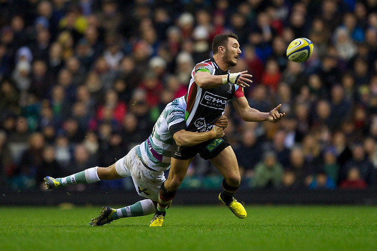 George Lowe of Harlequins offloads as he is tackled during the Aviva Premiership match between Harlequins and London Irish at Twickenham on Saturday 29th December 2012 (Photo by Rob Munro).