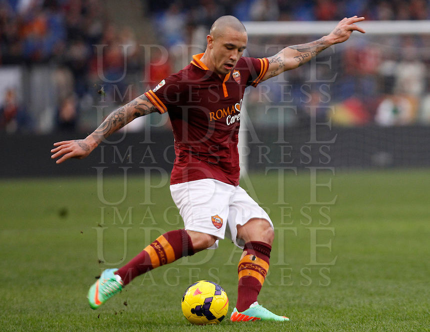 Calcio, Serie A: Roma-Genoa. Roma, stadio Olimpico, 12 gennaio 2014.<br /> AS Roma midfielder Radja Nainggolan, of Belgium, in action during the Italian Serie A football match between AS Roma and Genoa, at Rome's Olympic stadium, 12 January 2014. <br /> UPDATE IMAGES PRESS/Isabella Bonotto