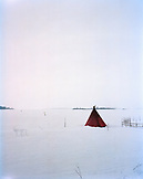 FINLAND, Kemi, Arctic, a teepee on snow-covered landscape