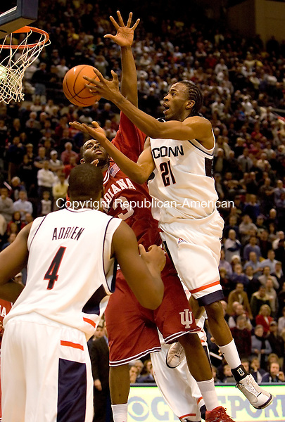 HARTFORD, CT--20 January 2007--012007JS03- UConn's Stanley Robinson put up a shot over<br /> Indiana's Mike White during their game Saturday at the Hartford Civic Center.<br /> Jim Shannon / Republican-American