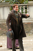 "MATTHEW MacFADYEN.On the set of Charles Dickins serial novel, period drama ""Little Dorrit"" filming near St. John's Church in Hampstead, London, England, Bank Holiday Monday, August 25th 2008..filmset film set Full length costume Victorian hat brown coat green bow tie arm.CAP/IA.©Ian Allis/Capital Pictures"