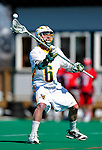 19 March 2011: University of Vermont Catamount LSM Max Gradinger, a Senior from Rancho Santa Fe, CA, in action against the St. John's University Red Storm at Moulton Winder Field in Burlington, Vermont. The Catamounts defeated the visiting Red Storm 14-9. Mandatory Credit: Ed Wolfstein Photo