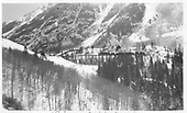 RGS rotary #2 in mid-span of Bridge 45-A at Ophir with 2 C-class engines and 2 cabooses headed southbound.<br /> RGS  Ophir, CO  1937
