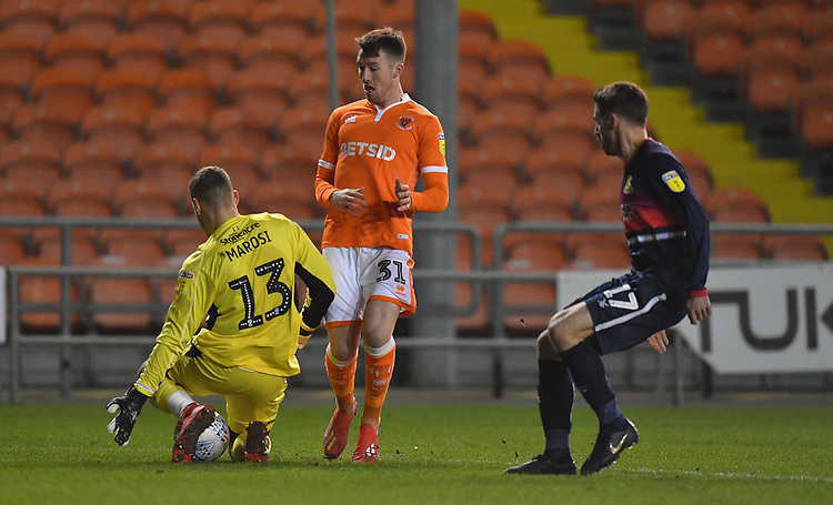 Blackpool's Chris Long battles with Doncaster Rovers' Marko Marosi<br /> <br /> Photographer Dave Howarth/CameraSport<br /> <br /> The EFL Sky Bet League One - Blackpool v Doncaster Rovers - Tuesday 12th March 2019 - Bloomfield Road - Blackpool<br /> <br /> World Copyright © 2019 CameraSport. All rights reserved. 43 Linden Ave. Countesthorpe. Leicester. England. LE8 5PG - Tel: +44 (0) 116 277 4147 - admin@camerasport.com - www.camerasport.com