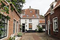 Huis gebouwd in de  oude verdedigingsmuur