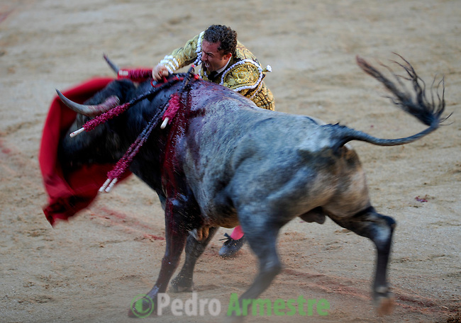Spanish matador Rafael Rubio Rafaelillo kills a Miura bull during a bullfight of the San Fermin festival at Pamplona's bullring on July 8, 2012, in Pamplona, northern Spain. The festival is a symbol of Spanish culture that attracts thousands of tourists to watch the bull runs despite heavy condemnation from animal rights groups . (c) Pedro ARMESTRE