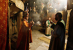 Christian worshippers pray inside the Grotto at the Church of the Nativity, believed to be the birthplace of Jesus Christ, in the West Bank city of Bethlehem, on December 20, 2015. Photo by Wisam Hashlamoun