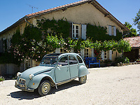 A Citroen 2CV is parked in front of Jemima French's country house in Bergerac