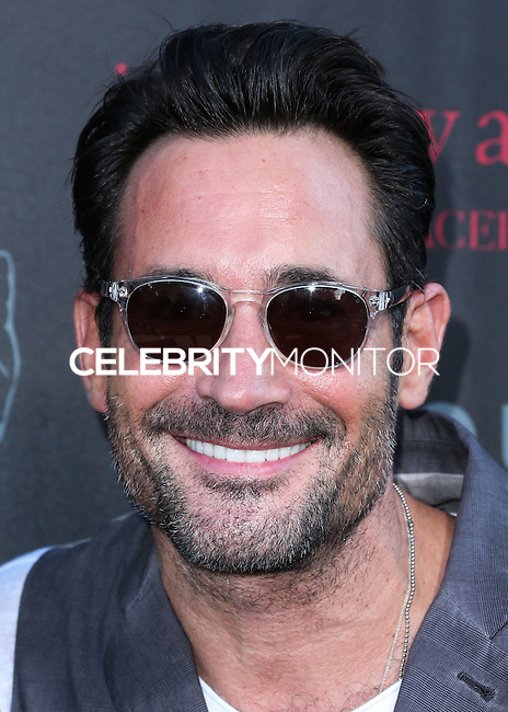 WEST HOLLYWOOD, CA, USA - SEPTEMBER 21: Gregory Zarian arrives at the John Varvatos #PeaceRocks Ringo Starr Private Concert held at the John Varvatos Boutique on September 21, 2014 in West Hollywood, California, United States. (Photo by Xavier Collin/Celebrity Monitor)