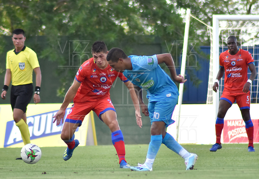 MONTERIA - COLOMBIA, 11-08-2019: Harrison Mojica de Jaguares disputa el balón con Nicolas Roa de Pasto durante partido por la fecha 5 de la Liga Águila II 2019 entre Jaguares de Córdoba F.C. y Deportivo Pasto jugado en el estadio Jaraguay de la ciudad de Montería. / Harrison Mojica of Jaguares struggles the ball with Nicolas Roa of Pasto during match for the date 5 as part Aguila League II 2019 between Jaguares de Cordoba F.C. and Deportivo Pasto played at Jaraguay stadium in Monteria city. Photo: VizzorImage / Andres Rios / Cont