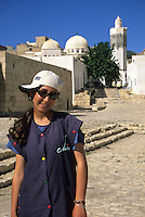 Tunisia, Le Kef.  Fourteen-year-old Tunisian Girl, Boumakhlouf Mosque in Background.