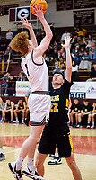 Westside Eagle Observer/RANDY MOLL<br /> Gentry's Casey Bates shoots over a Prairie Grove defender during play between the two teams in Gentry on Friday, Feb. 14, 2020. Though the Pioneers had the lead for a time in the first half, they fell behind and lost the final conference contest to the Tigers, 37-33.
