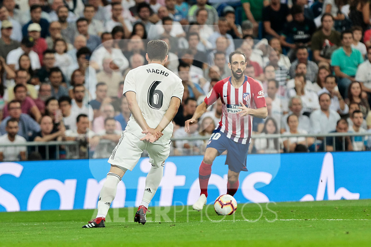 Real Madrid's Nacho Fernandez and Atletico de Madrid's Juanfran Torres during La Liga match between Real Madrid and Atletico de Madrid at Santiago Bernabeu Stadium in Madrid, Spain. September 29, 2018. (ALTERPHOTOS/A. Perez Meca)