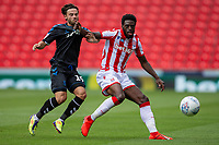27th June 2020; Bet365 Stadium, Stoke, Staffordshire, England; English Championship Football, Stoke City versus Middlesbrough; Bruno Martins Indi of Stoke City holds off Patrick Roberts of Middlesbrough