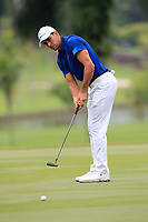 Rafa Cabrera Bello (Europe) on the 14th green during the Singles Matches of the Eurasia Cup at Glenmarie Golf and Country Club on the Sunday 14th January 2018.<br /> Picture:  Thos Caffrey / www.golffile.ie