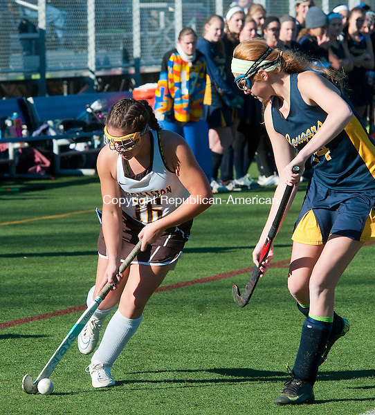 WETHERSFIELD, CT--- -112115JS02--Thomaston's Alexa Milius (16) runs the ball past Haddam-Killingworth's Kathryn Hausherr (24) during their Class S state finals game Saturday at Wethersfield High School.<br /> Jim Shannon Republican-American