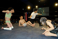 "Wrestlers (left to right) ""L'amant""  ""E.T"" and ""Orochi"". All three suffer from cerebral palsy. Only attacks to their afflicted areas are disallowed."