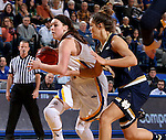 BROOKING, SD - NOVEMBER 21:  Ellie Thompson #45 from South Dakota State drives against Michaela Mabrey #23 from Notre  Dame in the first half of their game Saturday afternoon at Frost Arena in Brookings. (Photo by Dave Eggen/Inertia)
