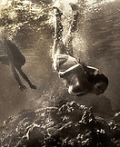 USA, Hawaii, women swimming underwater, Kealakekua Bay, The Big Island (B&W)