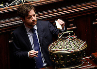 Il deputato Giuseppe Civati depone la scheda nell'urna durante la seduta comune di deputati e senatori per l'elezione del nuovo Presidente della Repubblica, alla Camera dei Deputati, Roma, 30 gennaio 2015.<br /> Italian deputy Giuseppe Civati casts his ballot during a joint plenary session of senators and deputies to vote for the election of the new President, at the Lower Chamber, Rome, 30 January 2015.<br /> UPDATE IMAGES PRESS/Riccardo De Luca