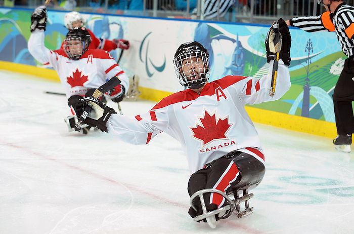 Greg Westlake (12) celebrates a first period goal during 2010 Paralympic Games sledge hockey action at UBC Thunderbird Arena in Vancouver. Credit: CPC/HC/Matthew Manor.