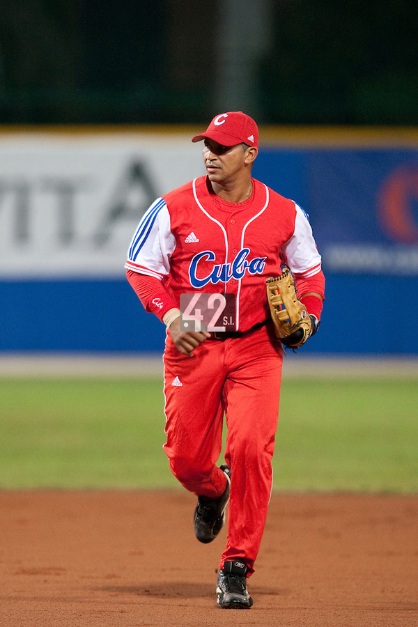 24 September 2009: Frederich Cepeda of Cuba is seen going back to the dugout during the 2009 Baseball World Cup final round match won 5-3 by Team USA over Cuba, in Nettuno, Italy.